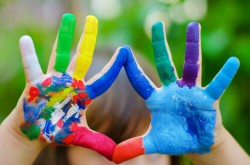 Child's hands painted in different bright colors ** Note: Slight blurriness, best at smaller sizes