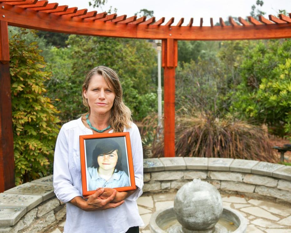 Katharine Prescott, holds a photo of her late son Kyler Prescott, in the memorial garden they created in his memory at their home in Vista, California September 21, 2016