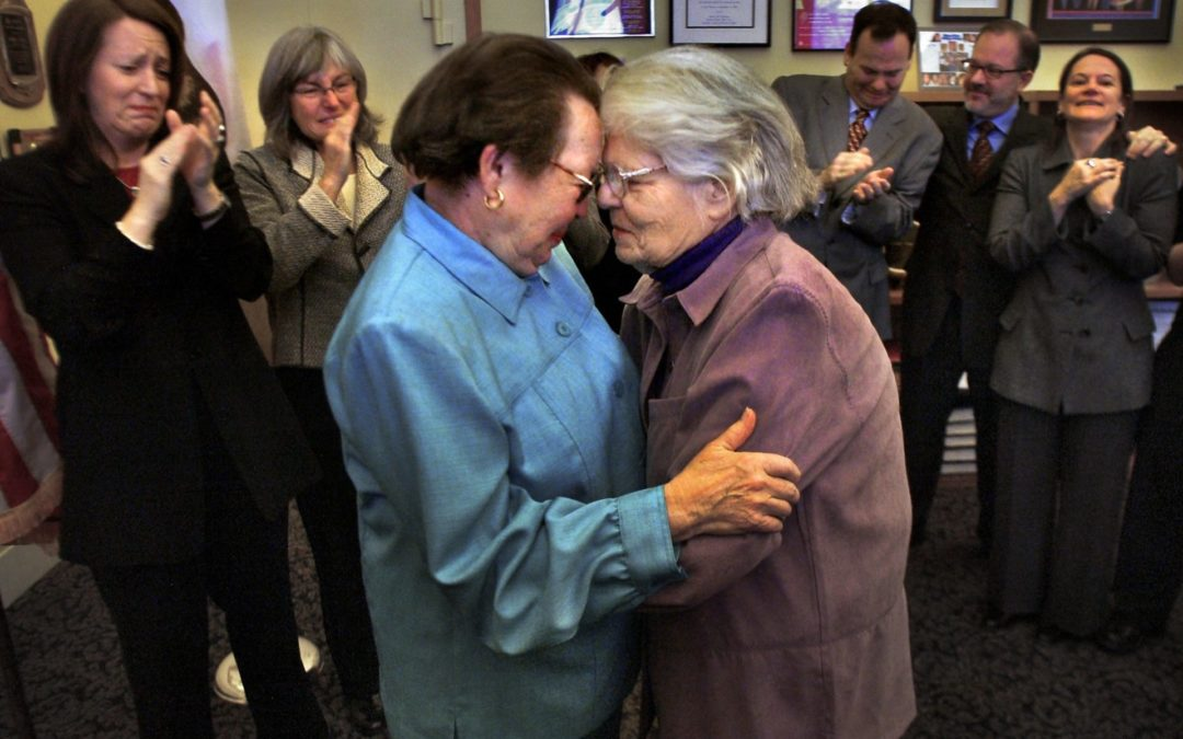Phyllis Lyon and Del Martin embrace after their marriage at City Hall in 2004.